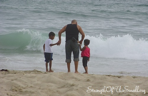 Father and Children on the Beach.